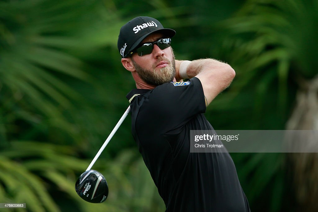 Graham DeLaet of Canada hits a shot during a practice round prior to the start of the World Golf Championships-Cadillac Championship at Trump National Doral on March 5, 2014 in Doral, Florida.