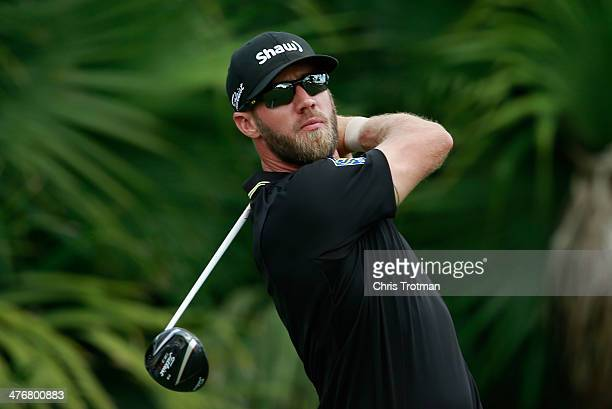Graham DeLaet of Canada hits a shot during a practice round prior to the start of the World Golf ChampionshipsCadillac Championship at Trump National...