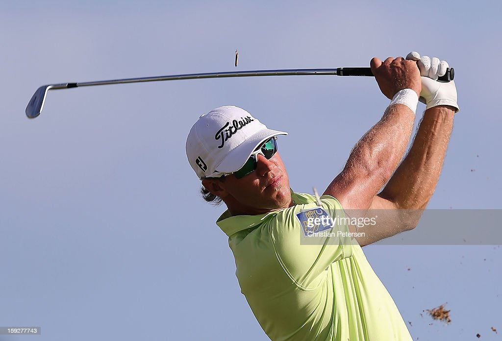 Graham DeLaet of Canada hits a tee shot on the 17th hole during the first round of the Sony Open in Hawaii at Waialae Country Club on January 10, 2013 in Honolulu, Hawaii.