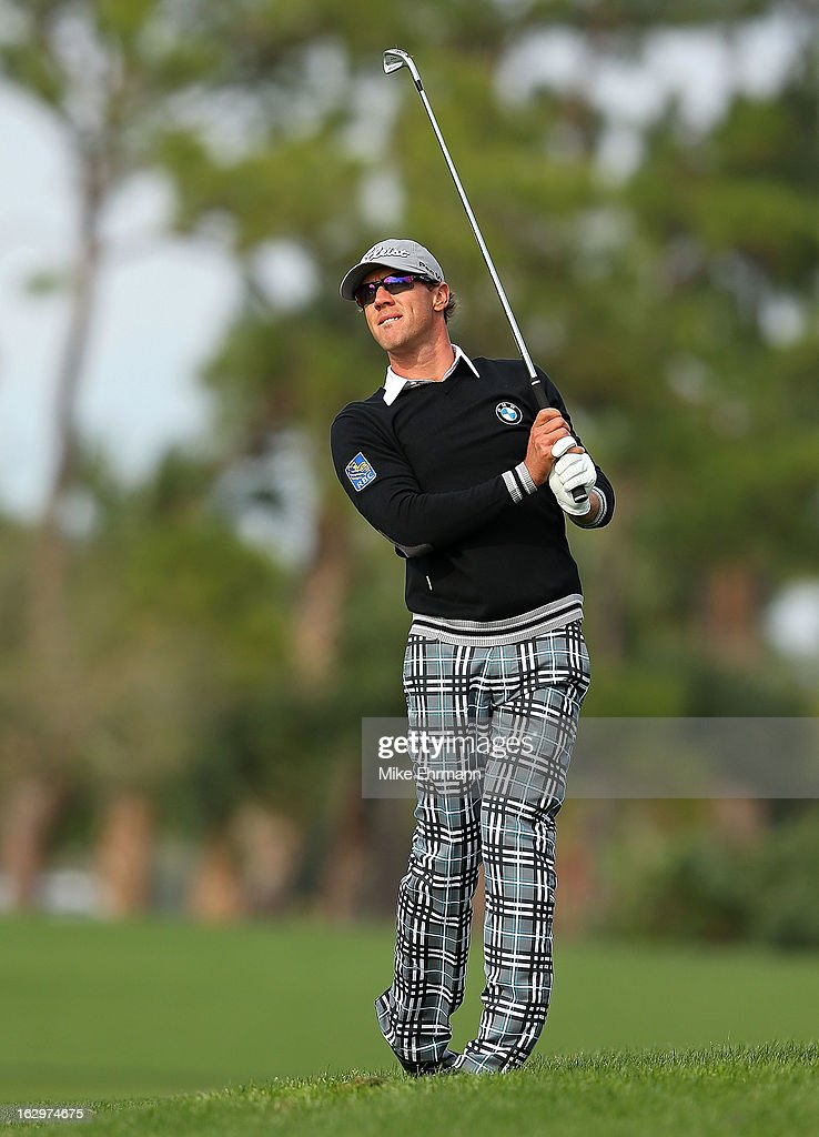 Graham DeLaet of Canada hits his approach shot on the 11th hole during the third round of the Honda Classic at PGA National Resort and Spa on March 2, 2013 in Palm Beach Gardens, Florida.