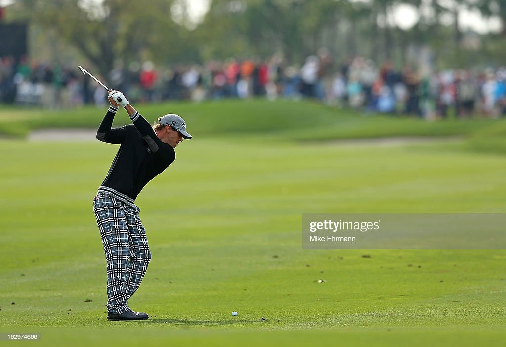 Graham DeLaet of Canada hits his approach shot on the tenth hole during the third round of the Honda Classic at PGA National Resort and Spa on March 2, 2013 in Palm Beach Gardens, Florida.