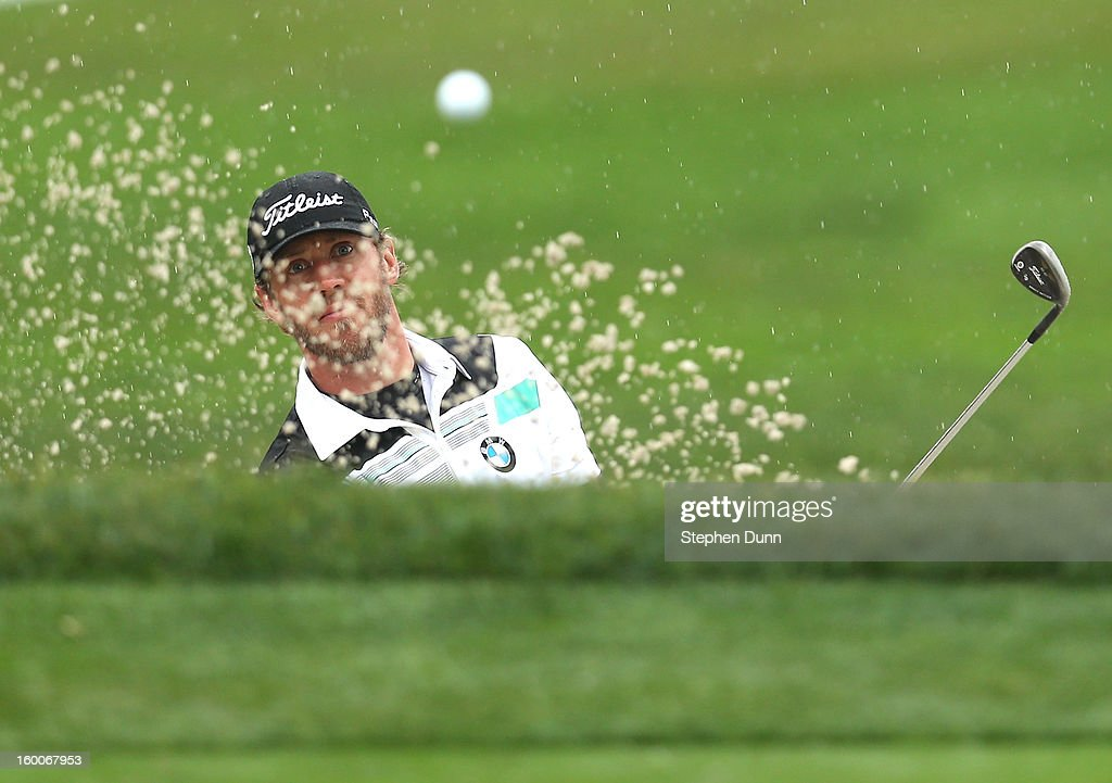 Graham DeLaet of Canada hits out of a bunker on the eighth hole during the second round of the Farmers Insurance Open on the South Course at Torrey Pines Golf Course on January 25, 2013 in La Jolla, California.