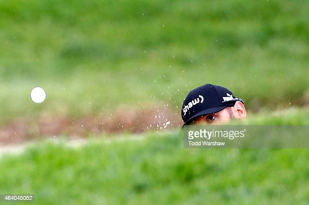 Graham DeLaet of Canada hits out of the bunker on the fourth hole on the fourth hole during round three of the Northern Trust Open at Riviera Country...