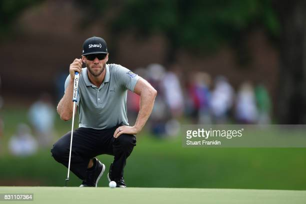 Graham DeLaet of Canada lines up a putt on the second green during the final round of the 2017 PGA Championship at Quail Hollow Club on August 13...