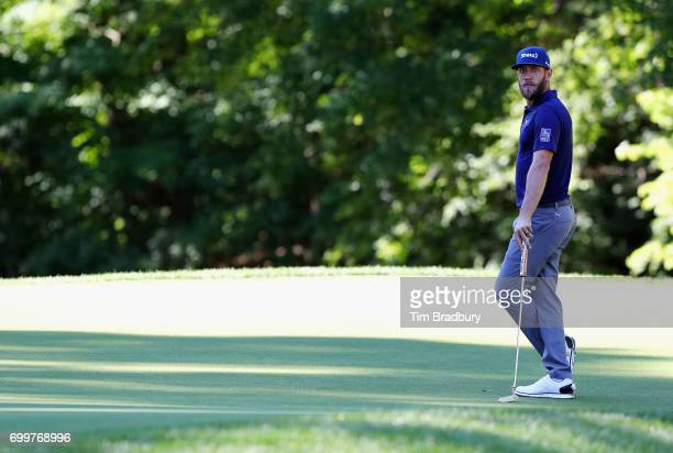 Graham DeLaet of Canada looks on from the 14th green during the first round of the Travelers Championship at TPC River Highlands on June 22 2017 in...