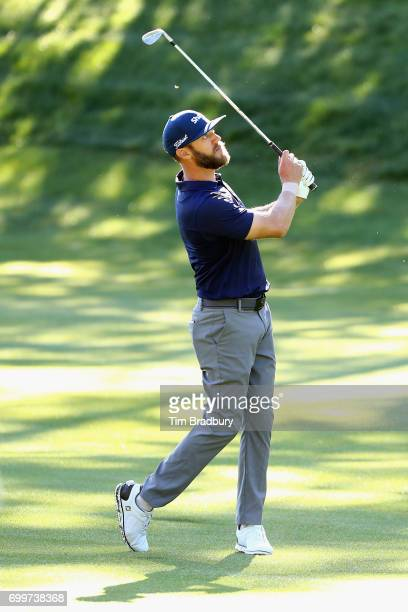Graham DeLaet of Canada plays a shot on the 14th hole during the first round of the Travelers Championship at TPC River Highlands on June 22 2017 in...