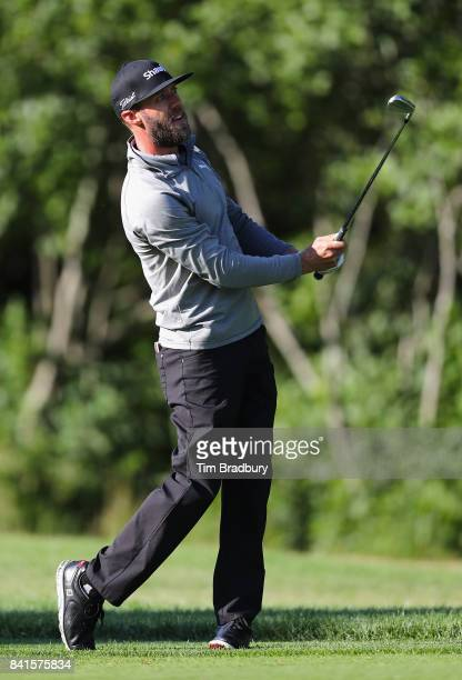 Graham DeLaet of Canada plays a shot on the tenth hole during round one of the Dell Technologies Championship at TPC Boston on September 1 2017 in...