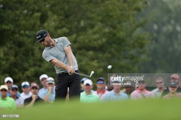 Graham DeLaet of Canada plays his shot from the 13th tee during the final round of the 2017 PGA Championship at Quail Hollow Club on August 13 2017...