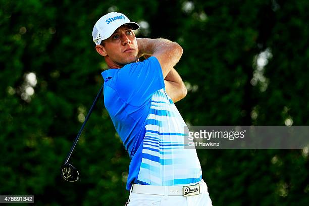 Graham DeLaet of Canada plays his shot from the ninth tee during the second round of the Travelers Championship at TPC River Highlands on June 26...