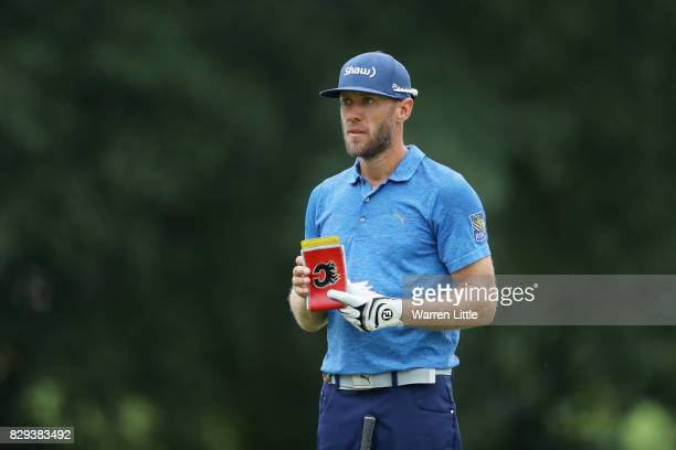 Graham Delaet of Canada prepares to play his shot on the third hole during the first round of the 2017 PGA Championship at Quail Hollow Club on...