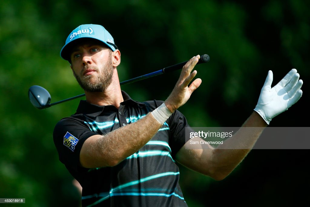 Graham DeLaet of Canada reacts after hitting off the 14th tee during the second round of the World Golf Championships-Bridgestone Invitational at Firestone Country Club South Course on August 1, 2014 in Akron, Ohio.