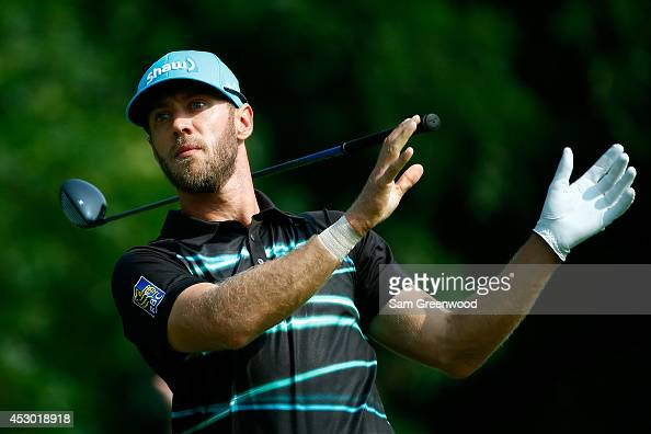 Graham DeLaet of Canada reacts after hitting off the 14th tee during the second round of the World Golf ChampionshipsBridgestone Invitational at...