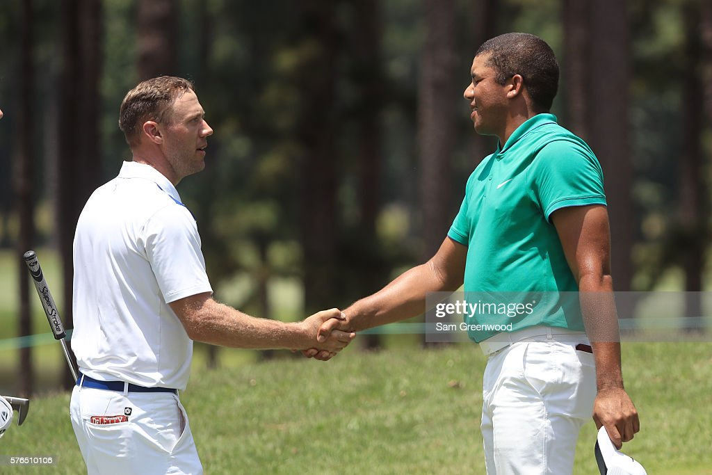Graham DeLaet of Canada (L) shakes hands with Jhonattan Vegas of Venezuela at the ninth green during the second round of the Barbasol Championship at the Robert Trent Jones Golf Trail at Grand National on July 15, 2016 in Auburn, Alabama.