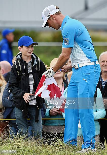 Graham Delaet of Canada signs his autograph for a fan ahead of the 144th Open Championship at The Old Course on July 15 2015 in St Andrews Scotland