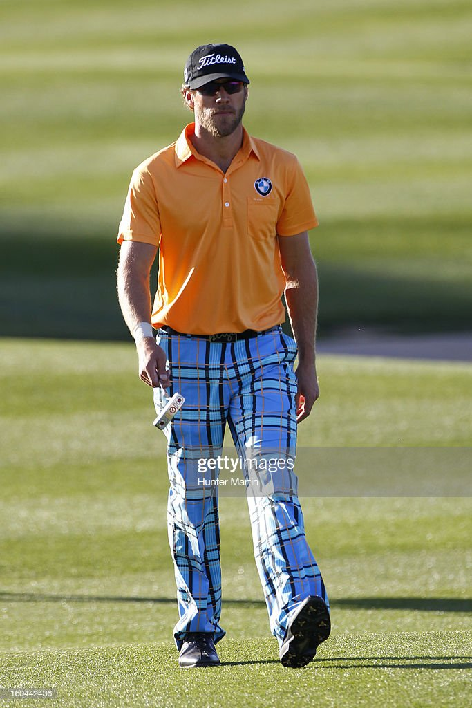 Graham DeLaet of Canada walks down the fairway on the ninth hole during the first round of the Waste Management Phoenix Open at TPC Scottsdale on January 31, 2013 in Scottsdale, Arizona.
