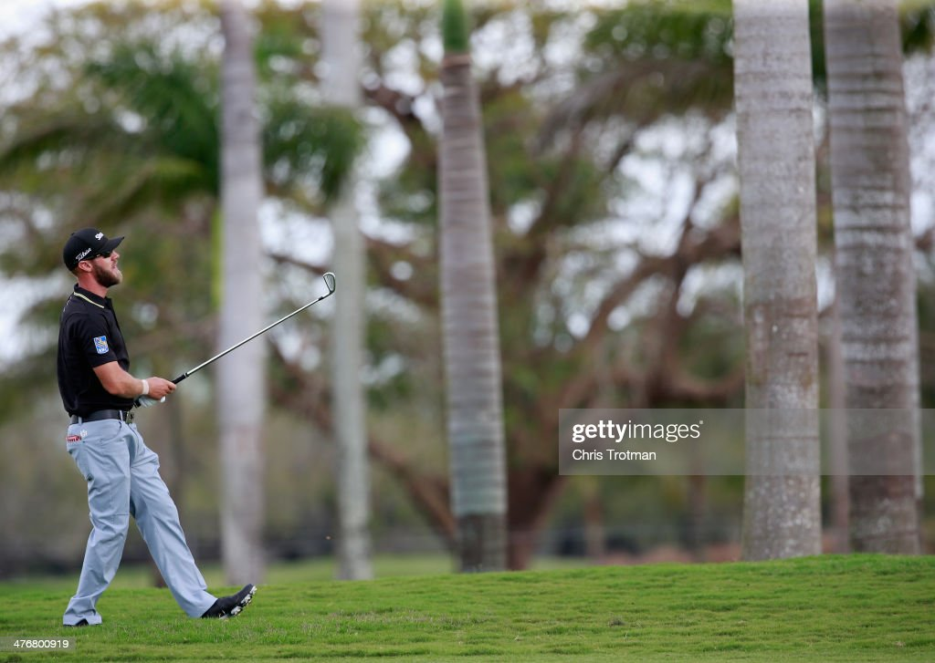 Graham DeLaet of Canada watches a shot during a practice round prior to the start of the World Golf Championships-Cadillac Championship at Trump National Doral on March 5, 2014 in Doral, Florida.