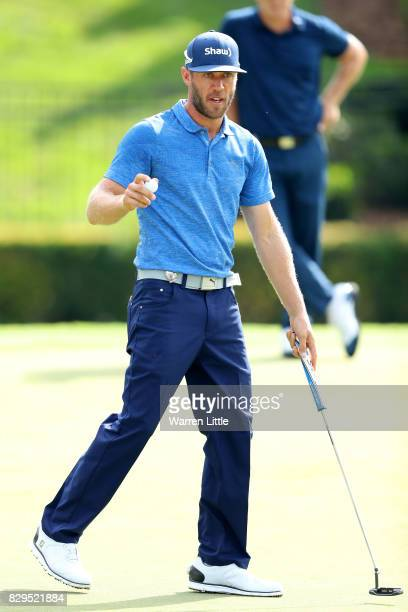 Graham DeLaet of Canada waves during the first round of the 2017 PGA Championship at Quail Hollow Club on August 10 2017 in Charlotte North Carolina