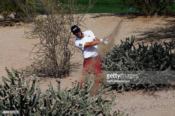 Graham DeLaet plays a shot on the 8th hole during the final round of the Waste Management Phoenix Open at TPC Scottsdale on February 2 2014 in...