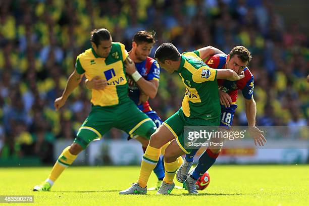 Graham Dorrans of Norwich City and James McArthur of Crystal Palace compete for the ball during the Barclays Premier League match between Norwich...
