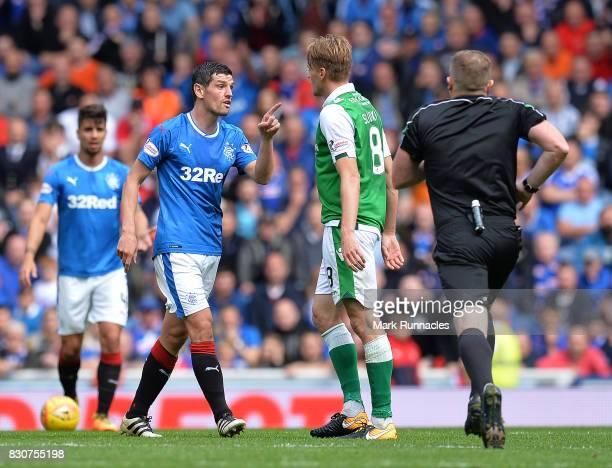 Graham Dorrans of Rangers squares up to Vykintas Slivka of Hiberbian during the Ladbrokes Scottish Premiership match between Rangers and Hibernian at...