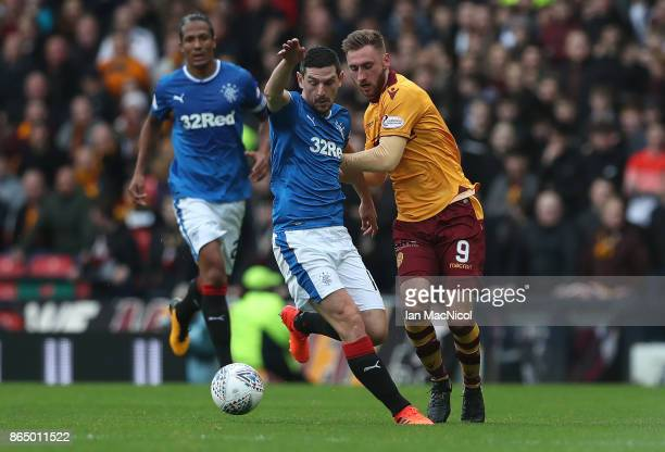 Graham Dorrans of Rangers vies with Louis Moult of Motherwell during the Betfred League Cup Semi Final between Rangers and Motherwell at Hampden Park...