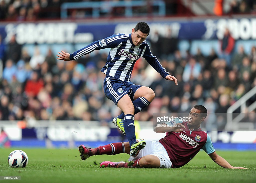 Graham Dorrans of West Bromwich Albion is tackled by <a gi-track='captionPersonalityLinkClicked' href=/galleries/search?phrase=Winston+Reid&family=editorial&specificpeople=5491819 ng-click='$event.stopPropagation()'>Winston Reid</a> of West Ham United during the Barclays Premier League match between West Ham United and West Bromwich Albion at the Boleyn Ground on March 30, 2013 in London, England.