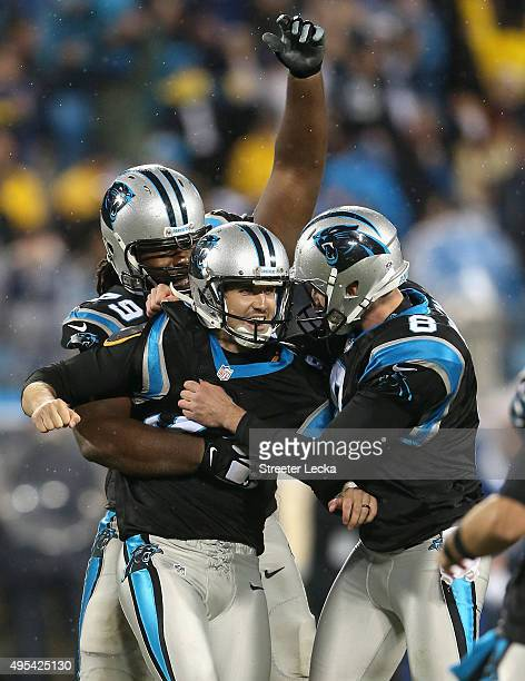 Graham Gano of the Carolina Panthers celebrates the game winning field goal with teammates Chris Scott and Brad Nortman defeating the Indianapolis...