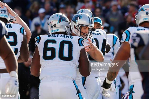 Graham Gano of the Carolina Panthers celebrates with Daryl Williams after kicking a 48yard field goal during the fourth quarter to defeat the New...