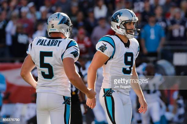 Graham Gano of the Carolina Panthers celebrates with Michael Palardy after kicking a 48yard field goal during the fourth quarter to defeat the New...