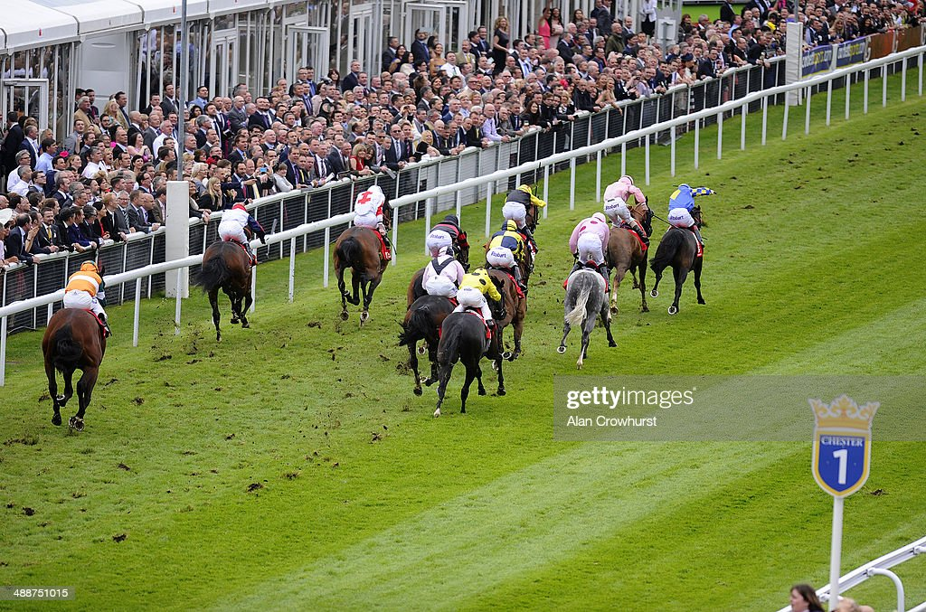Graham gibbons riding Tres Coronas (R) win The IG Handicap Stakes at Chester racecourse on May 08, 2014 in Chester, England.