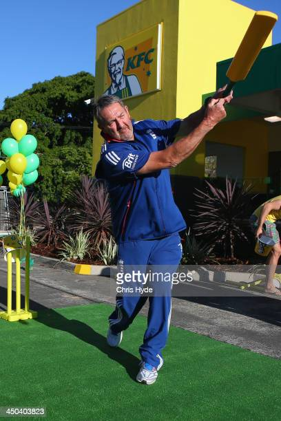 Graham Gooch bats infront of KFC in Brisbane transformed to Green Gold in support of Australian Cricket on November 19 2013 in Brisbane Australia