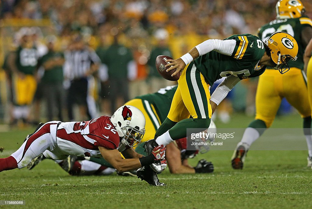 <a gi-track='captionPersonalityLinkClicked' href=/galleries/search?phrase=Graham+Harrell&family=editorial&specificpeople=3941321 ng-click='$event.stopPropagation()'>Graham Harrell</a> #6 of the Green Bay Packers is sacked by <a gi-track='captionPersonalityLinkClicked' href=/galleries/search?phrase=Tyrann+Mathieu&family=editorial&specificpeople=7173040 ng-click='$event.stopPropagation()'>Tyrann Mathieu</a> #35 of the Arizona Cardinals at Lambeau Field on August 9, 2013 in Green Bay, Wisconsin.