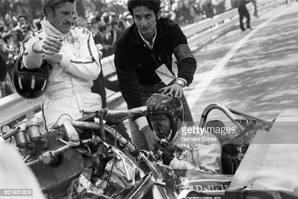 Graham Hill Jochen Rindt LotusFord 49B Grand Prix of Spain Montjuic 04 May 1969 Jochen Rindt after his accident caused by a rear wing failure He was...