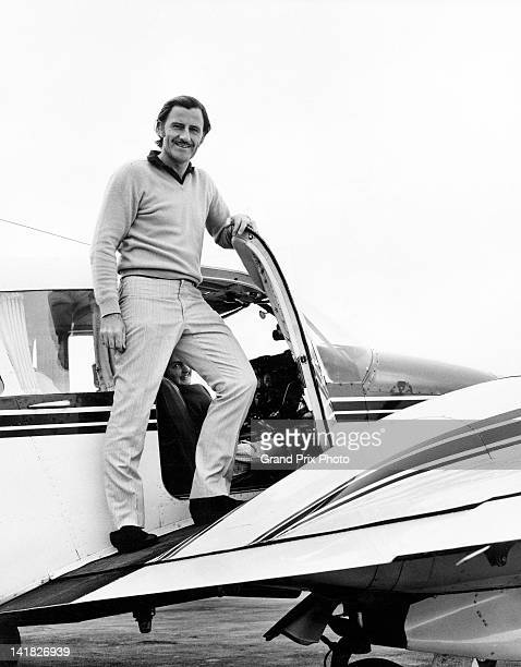 Graham Hill of Great Britain and driver of the Gold Leaf Team Lotus Lotus 49B Ford V8 poses for a portrait with his PA23 Piper Aztec twin engined...