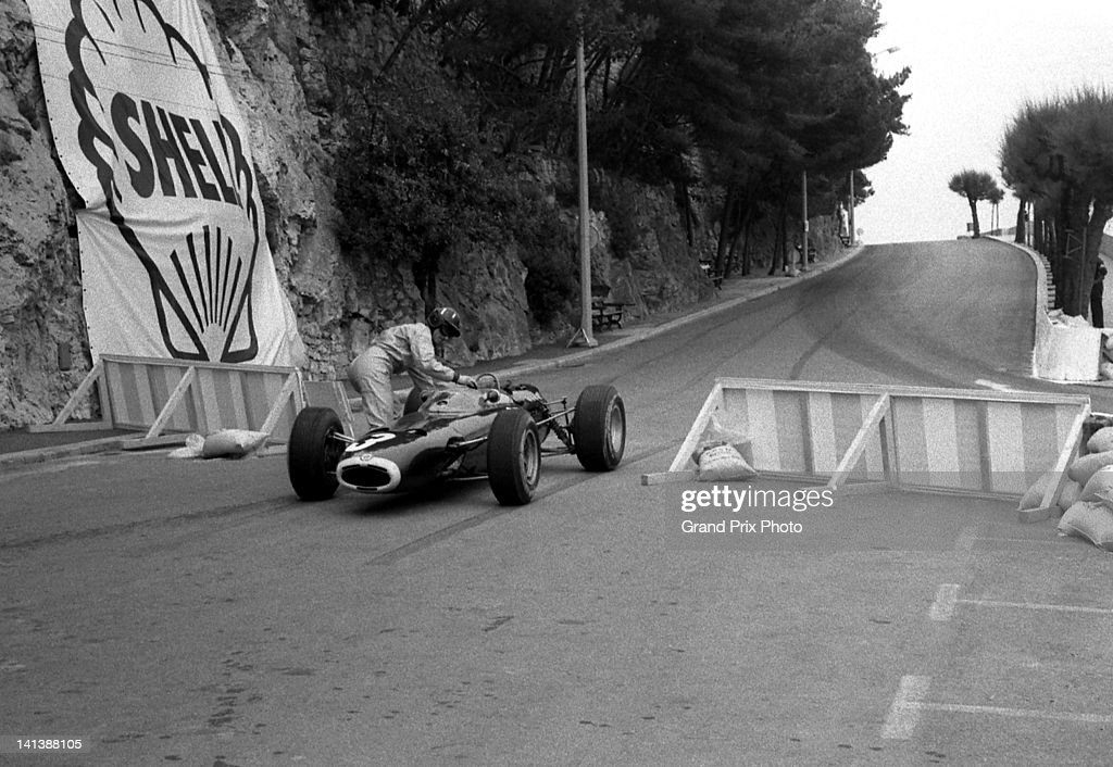 Graham Hill of Great Britain pushes the Owen Racing Organisation BRM P261 BRM V8 back onto the track during the Monaco Grand Prix on 30th May 1965...