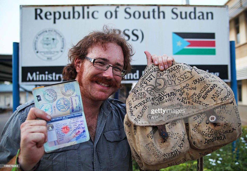 Graham Hughes from Liverpool in the United Kingdom, who claims to be the first person to have visited every sovereign nation on the globe without flying, poses with his belongings for a photograph, in Juba, South Sudan, on November 26, 2012. South Sudan was the last country on his list as it was not an independent country when he first started his trip. Graham Hughes, 33, took almost four years to tick off 201 countries off his list, including all 193 members of the United Nations. Hughes was raising funds for British charity Water Aid during his record attempt. AFP PHOTO / HANNAH MCNEISH