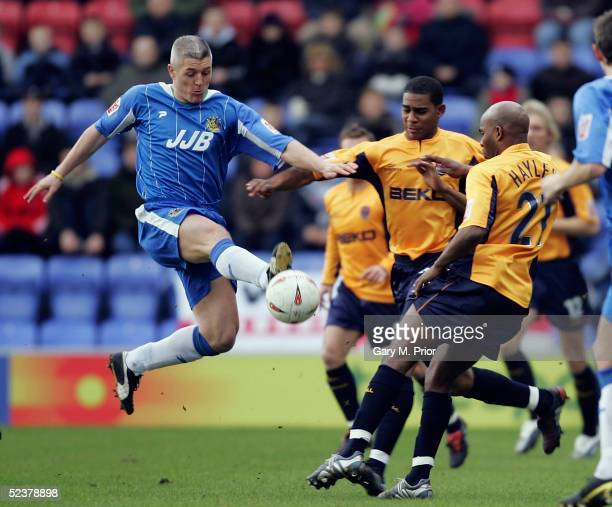 Graham Kavanagh of Wigan Athletic tries to bring the ball under control during the CocaCola Championship match between Wigan Athletic and Millwall at...