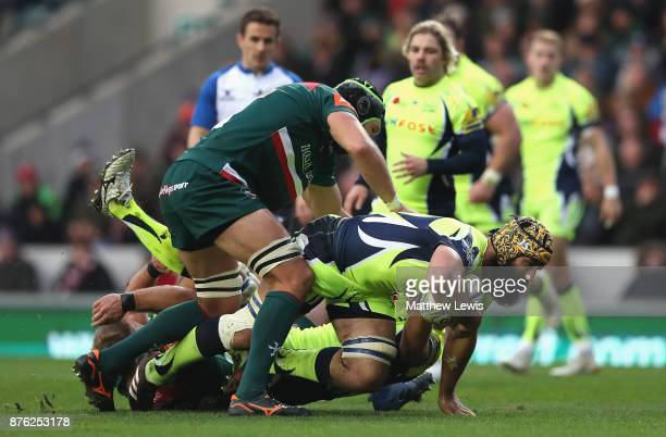 Graham Kitchener of Leicester Tigers tackles Josh Strauss of Sale Sharks during the Aviva Premiership match between Leicester Tigers and Sale Sharks...