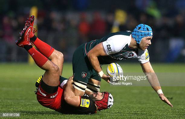 Graham Kitchener of Leicestser is tackled by Schalk Brits during the Aviva Premiership match between Saracens and Leicester Tigers at Allianz Park on...
