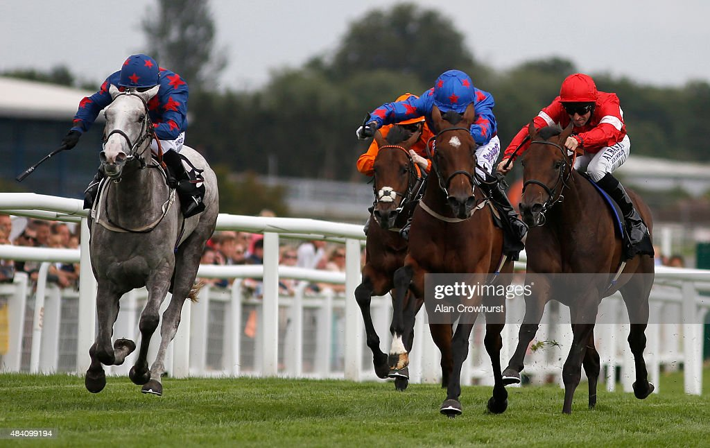 Graham Lee riding Epson Icon (2R) win The Denford Stud Stakes at Newbury racecourse on August 15, 2015 in Newbury, England.