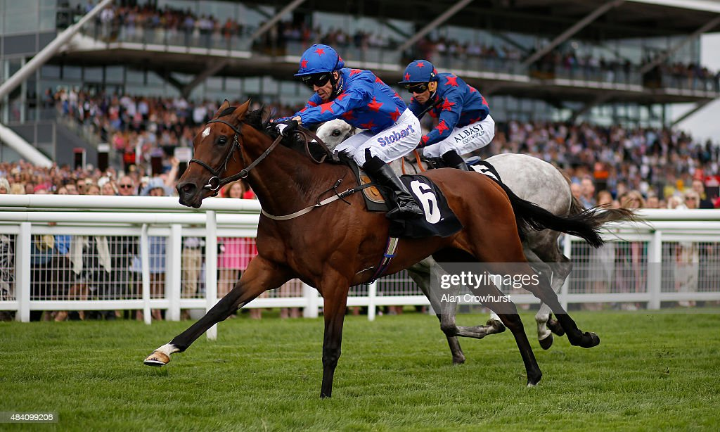 Graham Lee riding Epson Icon win The Denford Stud Stakes at Newbury racecourse on August 15 2015 in Newbury England