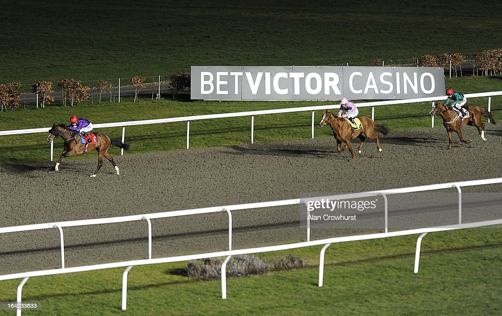 <a gi-track='captionPersonalityLinkClicked' href=/galleries/search?phrase=Graham+Lee&family=editorial&specificpeople=214664 ng-click='$event.stopPropagation()'>Graham Lee</a> riding Flying Tempo win The BetVictor Non Runner No Bet At Aintree Handicap Stakes at Kempton racecourse on March 21, 2013 in Sunbury, England.