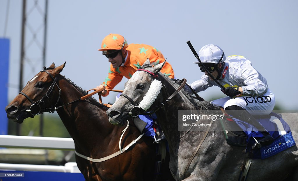 Graham Lee riding Prince Johanne win The Coral Challenge Handicap at Sandown racecourse on July 06 2013 in Esher England