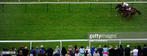 Graham Lee riding Spiraea win The Bill Garnett Memorial Fillies' Handicap Stakes at Salisbury racecourse on August 14 2014 in Salisbury England