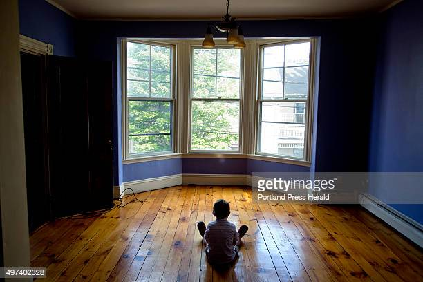 Graham Lovell sits on the floor or his family's new West End apartment Wednesday June 10 2015 The Lovells had to live in a motel in Old Orchard Beach...