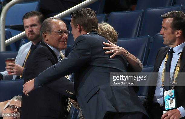 Graham McPhee reacts in the seating area after being selected 149th overall by the Edmonton Oilers during the 2016 NHL Draft at First Niagara Center...