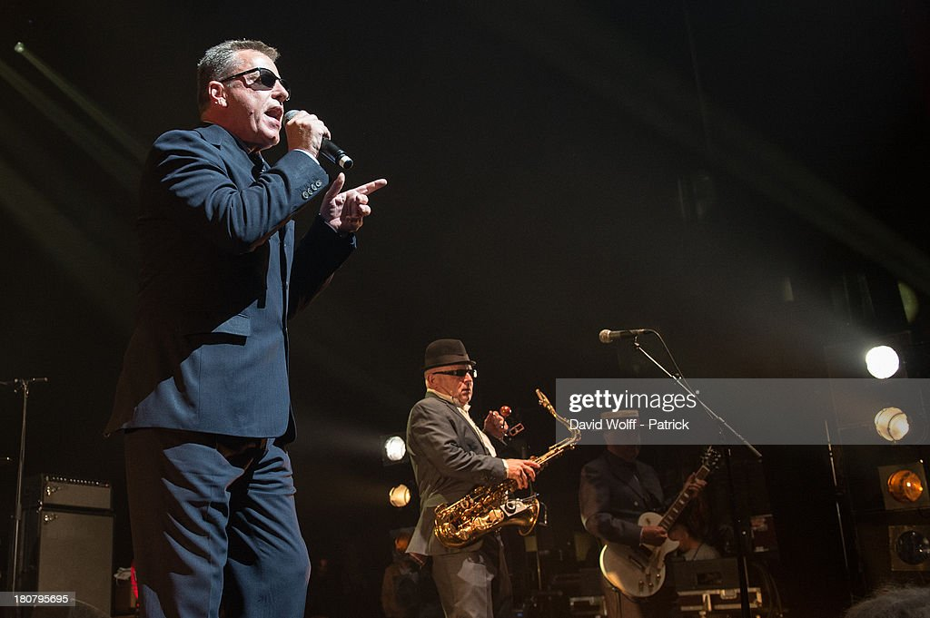 Graham McPherson and Lee Tompson from Madness perform at L'Olympia on September 16, 2013 in Paris, France.