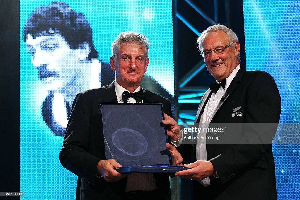 Graham Mourie is presented with the Steinlarger Salver for an Outstanding Contribution to New Zealand Rugby award from Mike Eagle during the 2013 Steinlager Rugby Awards at SkyCity Convention Centre on December 5, 2013 in Auckland, New Zealand.