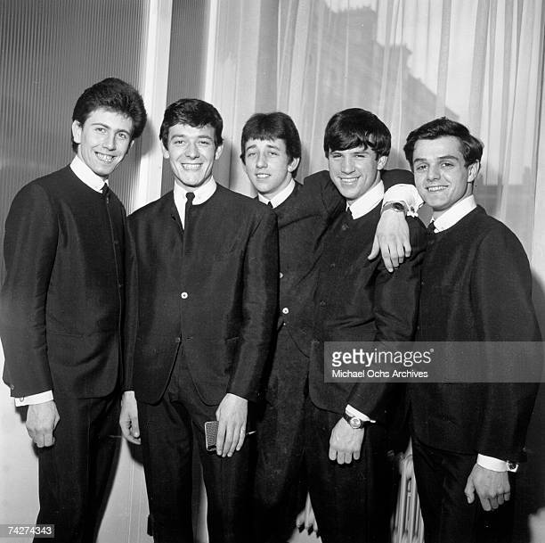 Graham Nash Allan Clarke Tony Hicks Bernie Calvert and Don Rathbone of the rock group 'The Hollies' pose for a portrait in 1962