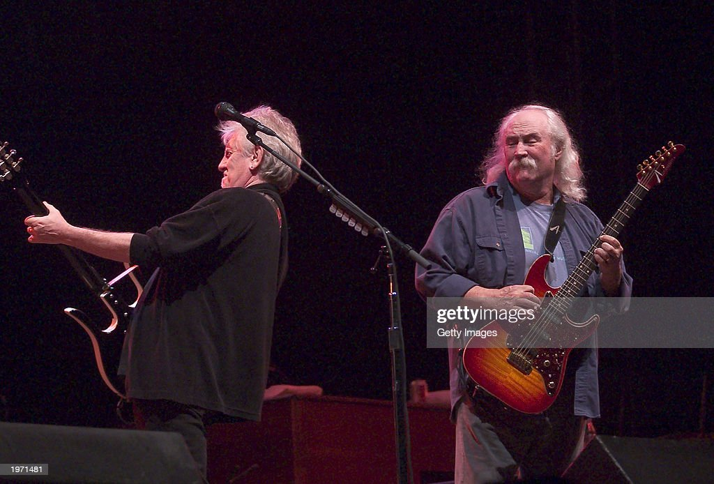 Graham Nash (L) and David Crosby, of Crosby, Stills and Nash, perform May 3, 2003 during the Music Midtown concert in Atlanta, Georgia. The Music Midtown event features over 120 international, national and local musical acts performing on 11 stages over a 3-day period on a 40 acre complex.